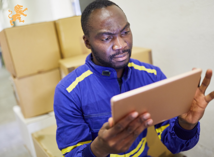 warehouse worker uses computer